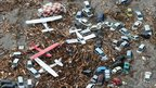 Light planes and vehicles sit among the debris after they were swept by a tsunami that struck Sendai Airport