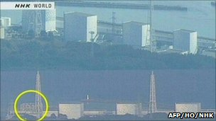 Video grab from NHK TV with before and after images of Fukushima 1 power plant showing damaged building on lower left - 12 March 2011