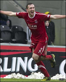Rory McArdle celebrates his equaliser for Aberdeen