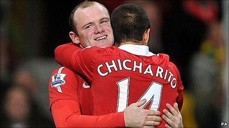 Wayne Rooney celebrates with Javier Hernandez
