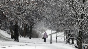 A woman walking in the snow in Denny, central Scotland