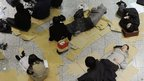 People taking shelter at the Metropolitan Government Headquarters in Tokyo sleep on the floor