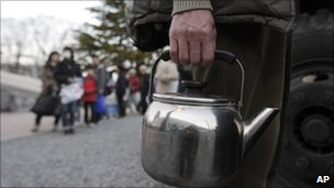 Residents queue for emergency water supplies in Koriyama