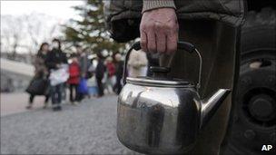 Residents queue for emergency water supplies in Koriyama