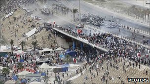 Violent clashes on a flyover near Pearl Square in Manama
