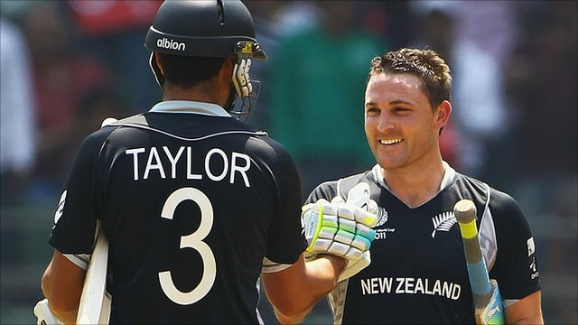Ross Taylor of New Zealand congratulates Brendon McCullum on his century