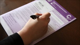Hand filling in census form