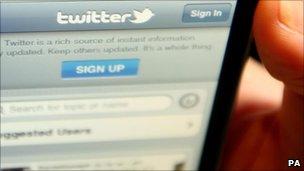 Twitter on handset, PA