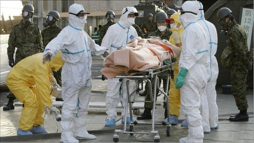 A person believed to be have been contaminated with radiation wrapped in a blanket in Fukushima prefecture