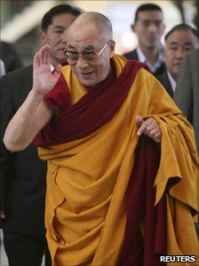 The Dalai Lama heads to a temple in Dharamsala to deliver a lesson on 14 March 2011