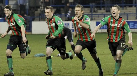 Glentoran players celebrate after the penalty shoot-out success