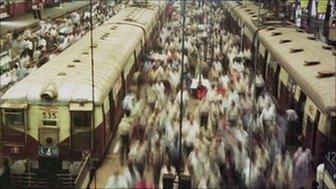 Thousands of commuters alight from trains enroute to work