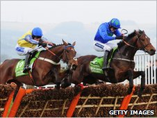 Hurricane Fly leads Peddlers Cross over the last