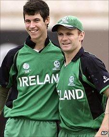 George Dockrell (left) celebrates a wicket
