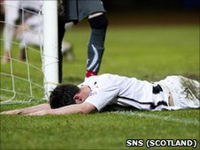 Joe Cardle lies prone in frustration after missing the target
