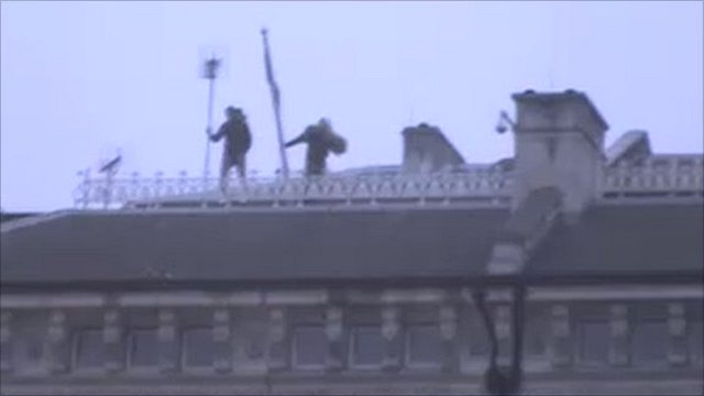 Protesters on Libyan embassy's roof