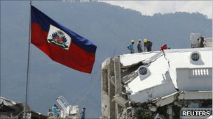 Workers remove debris from the presidential palace, severely damaged in the 2010 quake