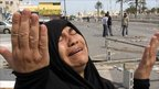 A Bahraini woman reacts in the Shia Muslim village of Dumistan, Bahrain. 16 March 2011.