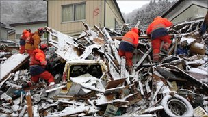 British rescuers search tsunami debris in Kamaishi