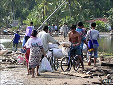 People salvage their belongings in Indonesia after the tsunami of 2004