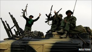 Government soldiers celebrate victory in Ajdabiyah, Libya (16 March 2011)