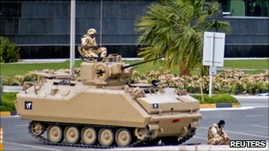 Gulf Co-operation Council troops with APC guarding financial district