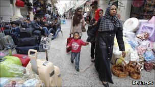 Women walk through a market in the old town of Tripoli on Tuesday