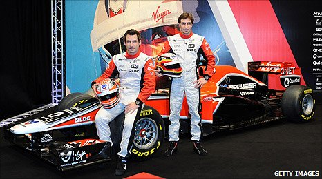 Timo Glock and Jerome d'Ambrosio pose with the 2011 Virgin car