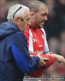 Craig Mitchell leaves the field against Ireland injured