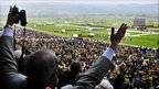 Racegoers celebrate as they watch Ruby Walsh and Quevega win the David Nicholson Mares Hurdle Race during Centenary Day at Cheltenham Racecourse (Photo by Tim Ireland/PA Wire)