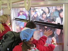 Pupils wave goodbye to friends in Japan