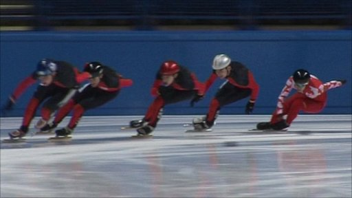 Speed skaters in action