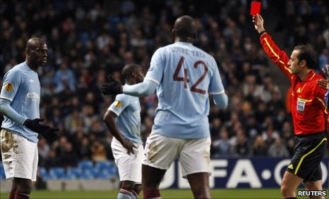Referee Vladimir Sajn sends off Manchester City's Mario Balotelli (right)