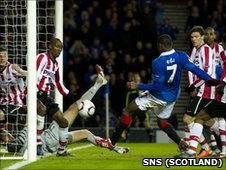 Maurice Edu had a shot blocked by a PSV hand