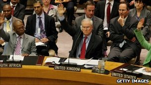 UN Security Council members vote for the resolution at the UN