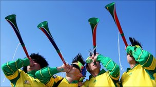 South African fans blow Vuvuzelas