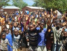 Pupils celebrate outside their primary school in Malawi