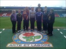 Pupils on the pitch at Blackburn Rovers