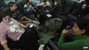 Iraqi Christians waiting to board a flight out of Iraq