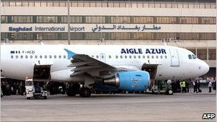 Aigle Azur French airliner parked outside Baghdad airport terminal