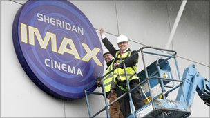 Workers remove Imax cinema sign