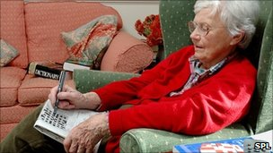Elderly woman doing the crossword