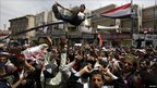 A Yemeni protester is thrown in the air in Sanaa, 17 march 2011
