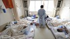 Patients wait to be rescued from a hospital where there is no electricity or medicine in Otsuchi town in Iwate Prefecture