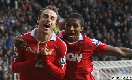 Dimitar Berbatov celebrates with Antonio Valencia
