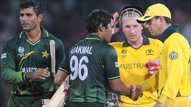 Australia's Ricky Ponting shakes hands with Pakistan batsman Umar Akmal