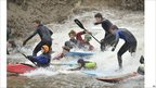 Surfers on Severn bore