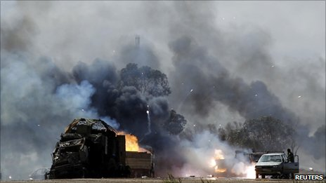 burning vehicles near Benghazi