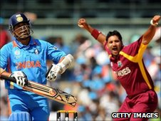 Sachin Tendulkar walks off as Ravi Rampaul celebrates