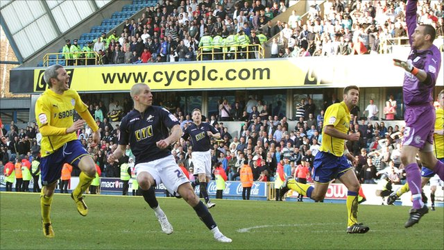Millwall's Steve Morison lobs home to equalise against Cardiff